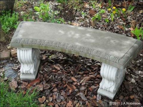 a concrete garden bench