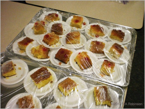 A tray of cake slices on individual styrofoam plates.
